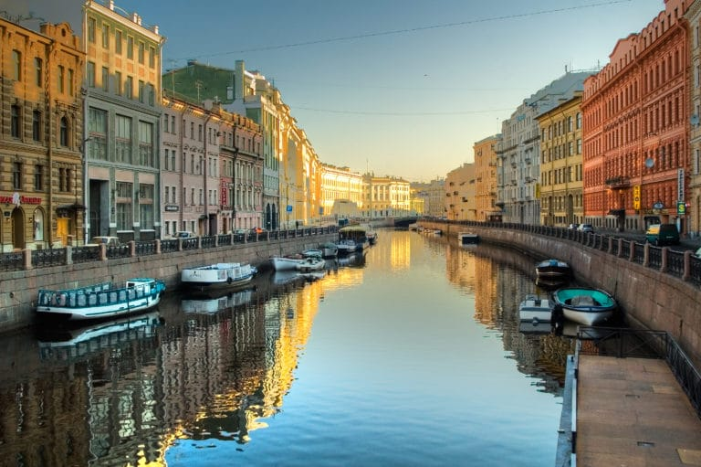 View at Pevchesky Bridge through oyka river with boats in Saint-Petersburg. Spring